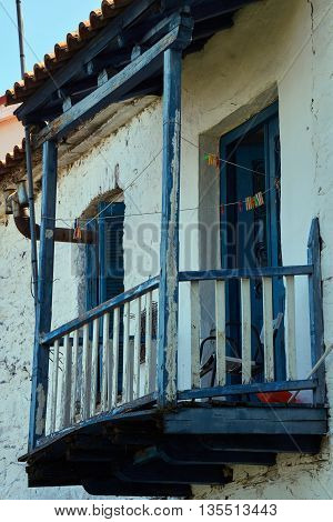 Wooden balcony in an old house in Greece
