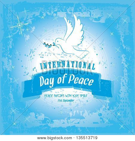 Peace dove with olive branch for International Peace Day poster on a blue grungy effect