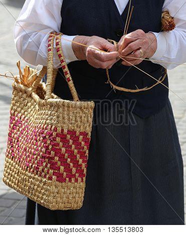 Elderly Woman With Straw Bag Walking