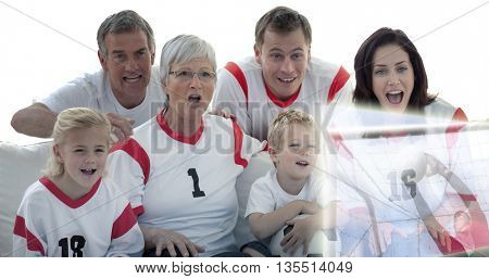 Composite image of excited family watching a football match in television at home