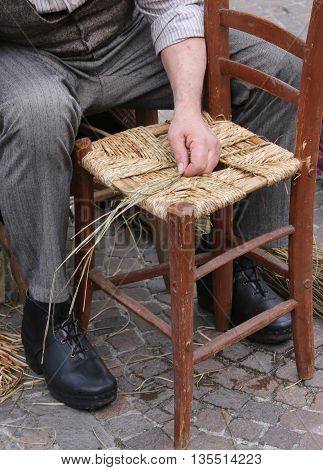 Old Mender Of Chairs While With Straw Shelters The Old Wooden Ki