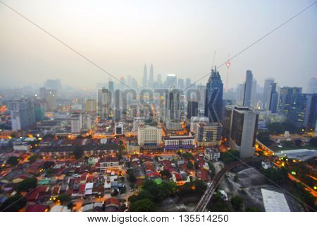 City Skyline in Malaysia at Twilight Blurred Defocused Bokeh Background