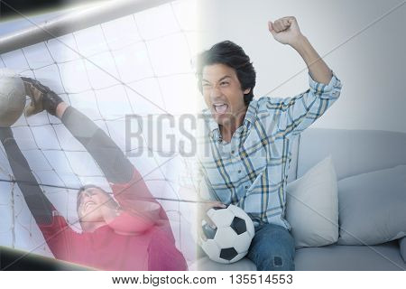 Composite image of man cheering soccer team during a match on television at home