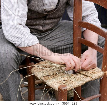Hands Of An Elderly Craftsman While Reparing