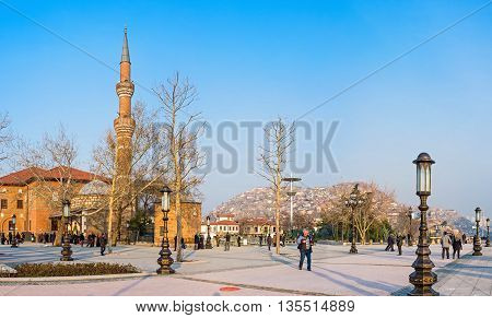 ANKARA TURKEY - JANUARY 16 2015: The Haci Bayram Square is the crowded place because the tourists and pilgrims visit the oldest Mosque in Turkey and discover the Augustus Temple next to it on January 16 in Ankara.
