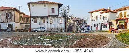 ANKARA TURKEY - JANUARY 16 2015: The square and the large flower bed in the tourist neighborhood of the city known as the Turkish village on January 16 in Ankara.