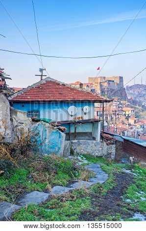 The old house in Ankara city center with the Hisar Citadel on the background Turkey.