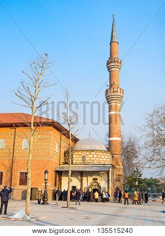 ANKARA TURKEY - JANUARY 16 2015: The entrance to the Haci Bayram Mosque with the numerous muslims coming to pray on January 16 in Ankara.