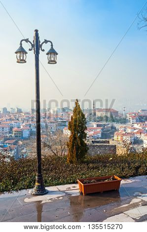 The lonely lantern on the Hisar Castle Hill with the old housing of Ankara on the background Turkey.