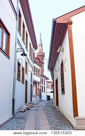 The restored cottages of old town with the Hisar Castle Hill on the background Ankara Turkey.