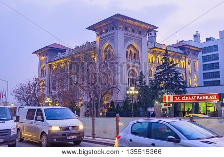 ANKARA TURKEY - JANUARY 16 2015: The evening view on the traffic jam on the road and the headquarters of the Ziraat Bank the country's largest and oldest financial institution on January 16 in Ankara.