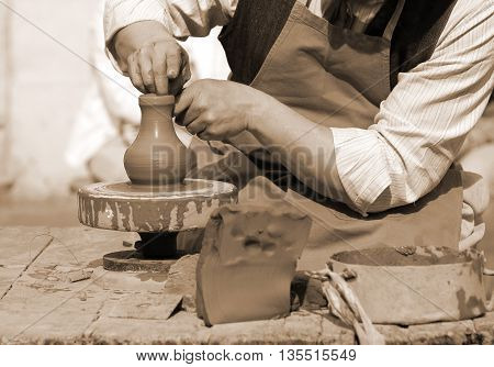Expert Potter Working With The Lathe