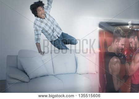 Composite image of excited man are watching boxing match on television at home