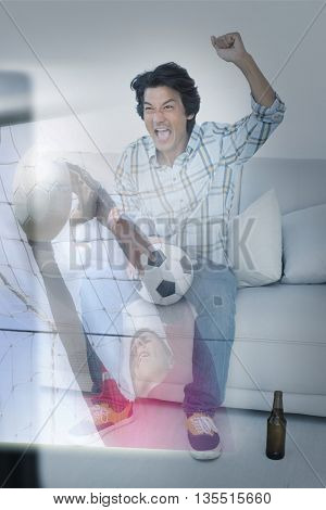 Composite image of happy man is watching sport on television at home