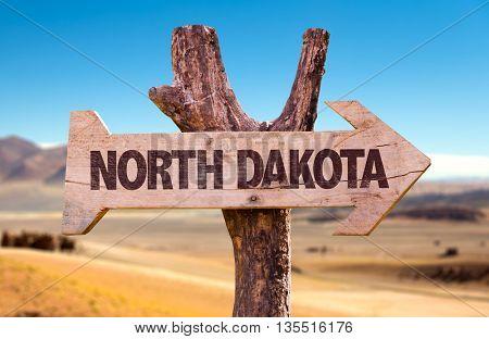North Dakota wooden sign with desert background