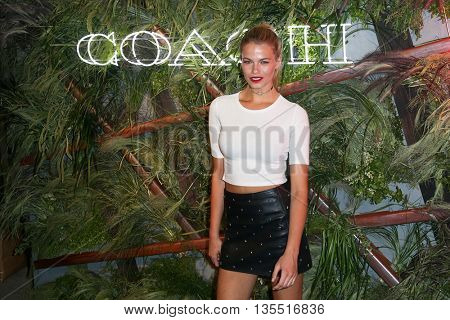 NEW YORK-JUNE 22: Hailey Clauson attends the 2016 Coach And Friends Of The High Line Summer Party at The High Line on June 22, 2016 in New York City.