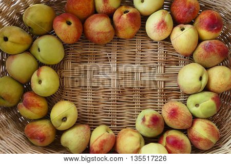 Some fresh peaches in a wood basket