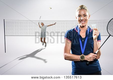 Composite image of badminton player posing with a medal against white background