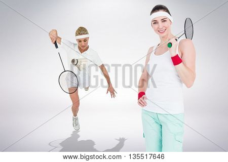Composite image of badminton players playing and posing against white background