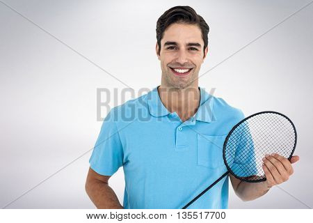 Composite image of badminton player holding badminton racket against white background