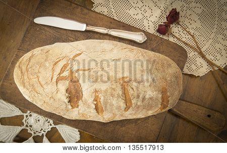 Traditional polish bread on a vintage cutting board