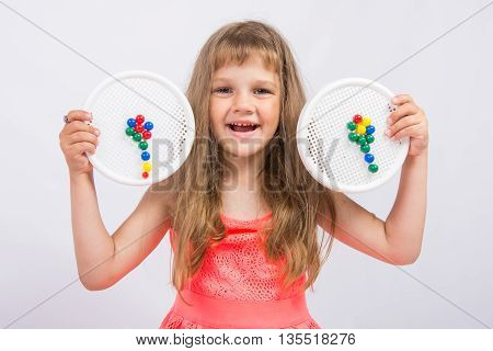 Girl Shows Colorful Flowers Collected From The Mosaic