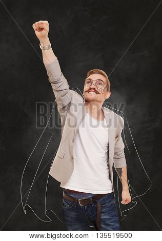 Man in superhero pose doing fly gesture. Imaginary super guy, super hero costume drawing at black gradient background. Young man shows flying pose, achievment, success, power, strong guy concept.