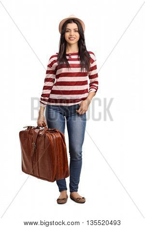 Full length portrait of a young cheerful woman carrying a travelling bag isolated on white background