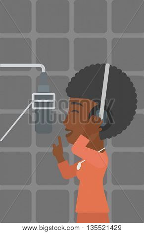 An african-american woman in headphones making a record of her voice in studio vector flat design illustration. Vertical layout.