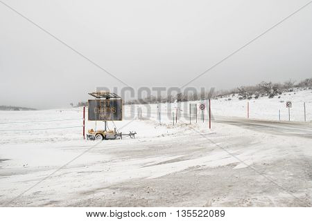 Perisher Valley - 23 June 2016: Chains required in Perisher Valley today after a night of snow falling