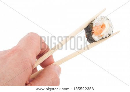 Sushi - Roll  with  hand holding chopsticks