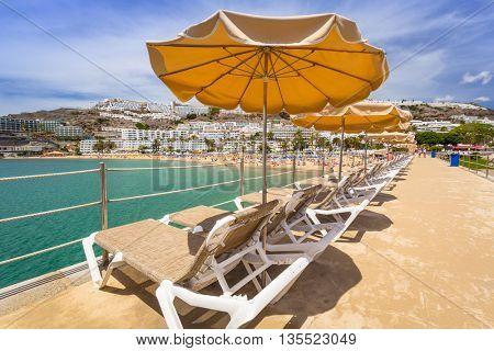 Parasols on the beach of Puerto Rico, Gran Canaria