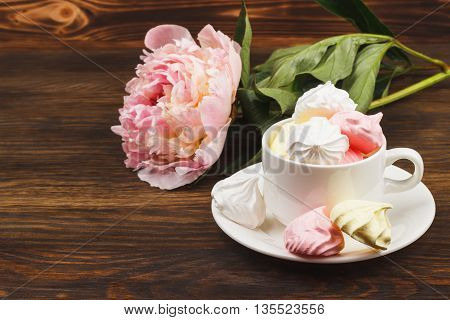 Cup With Light Pink And White Meringues
