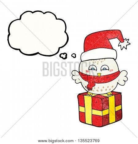 freehand drawn thought bubble textured cartoon cute christmas owl on wrapped present
