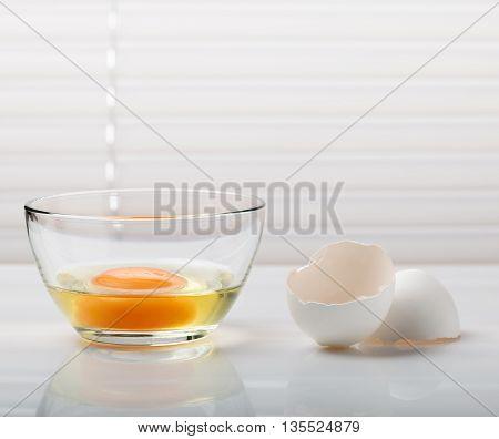 Broken Egg In Glass Bowl