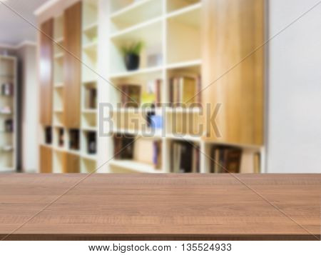 Wooden board empty table in front of blurred background. Perspective dark wood over blur in modern living room interior. Mock up for display or montage your products