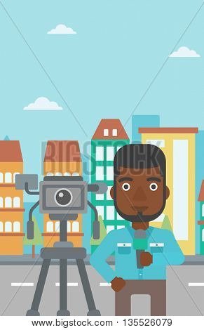 A camera filming and an african-american  reporter standing with a microphone on a city background vector flat design illustration. Vertical layout.
