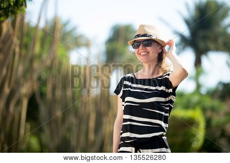 Young Woman Walking On Tropical Resort Street