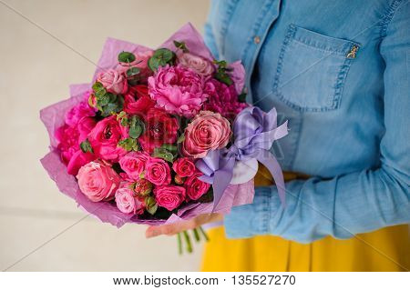 girl holding bouquet of a mixed pink and purple flowers no face