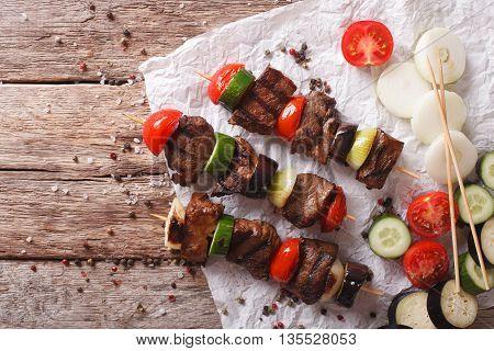 Tasty Kebab With Vegetables On Skewers Close-up. Horizontal Top View