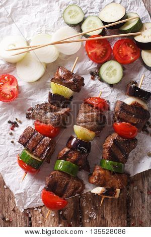 Delicious Kebab With Vegetables On Skewers Close-up. Vertical Top View