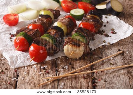 Roasted Meat With Vegetables On Skewers Close-up. Horizontal