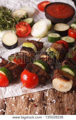Meat With Vegetables On Skewers Close-up On The Table. Vertical