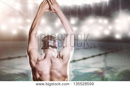 Composite image of swimmer preparing to dive against swimming pool