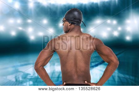 Rear view of swimmer on white background against view of a swimming pool