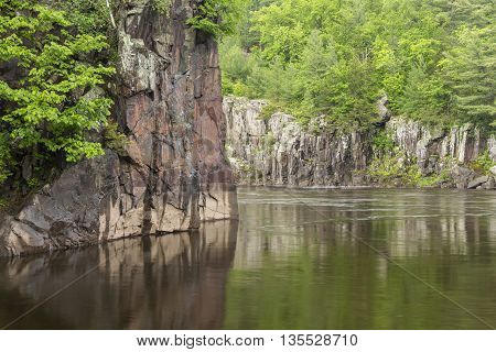 A scenic river with cliffs in spring.
