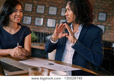 Man and woman discussing ideas for new business