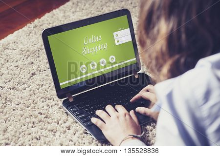 Online shopping website in a laptop computer. Woman buying by internet with a notebook at home.