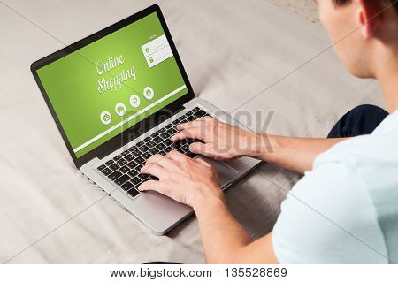Online shopping website in a laptop. Man buying by internet at home.