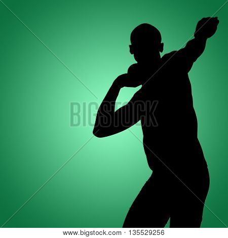 Front view of sportsman practising shot put against green vignette